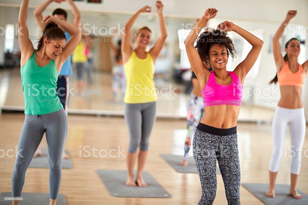 Cheerful women dance at gym stock photo