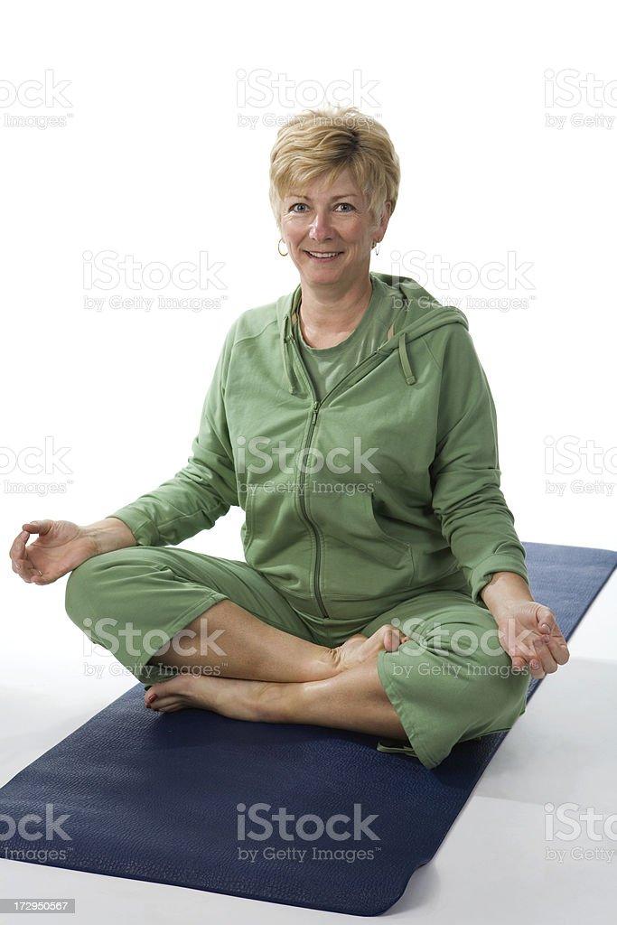 Cheerful yoga in green royalty-free stock photo