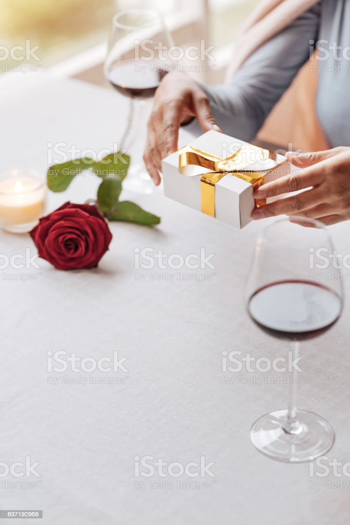 Cheerful young African American woman celebrating her birthday stock photo