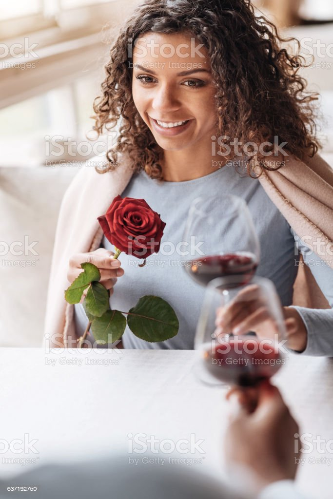 Cheerful young African American woman having the date stock photo