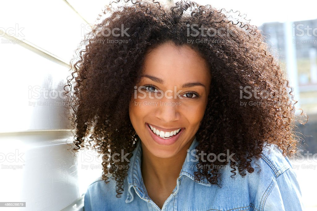 Cheerful young african american woman stock photo
