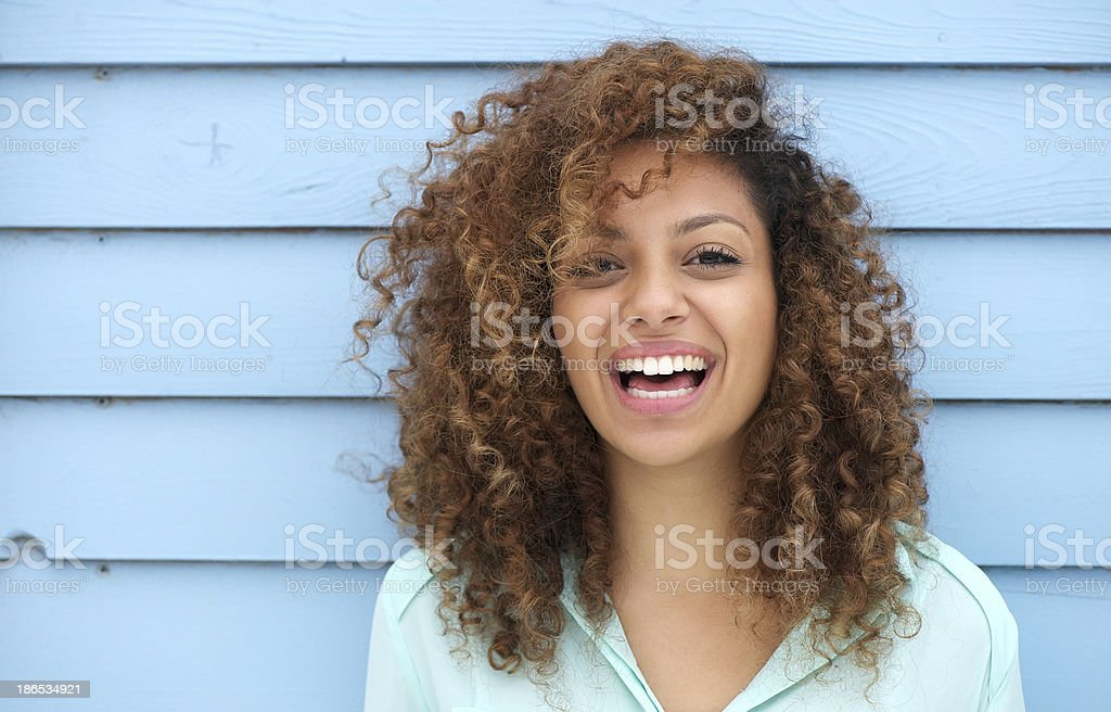 Cheerful young african woman smiling stock photo