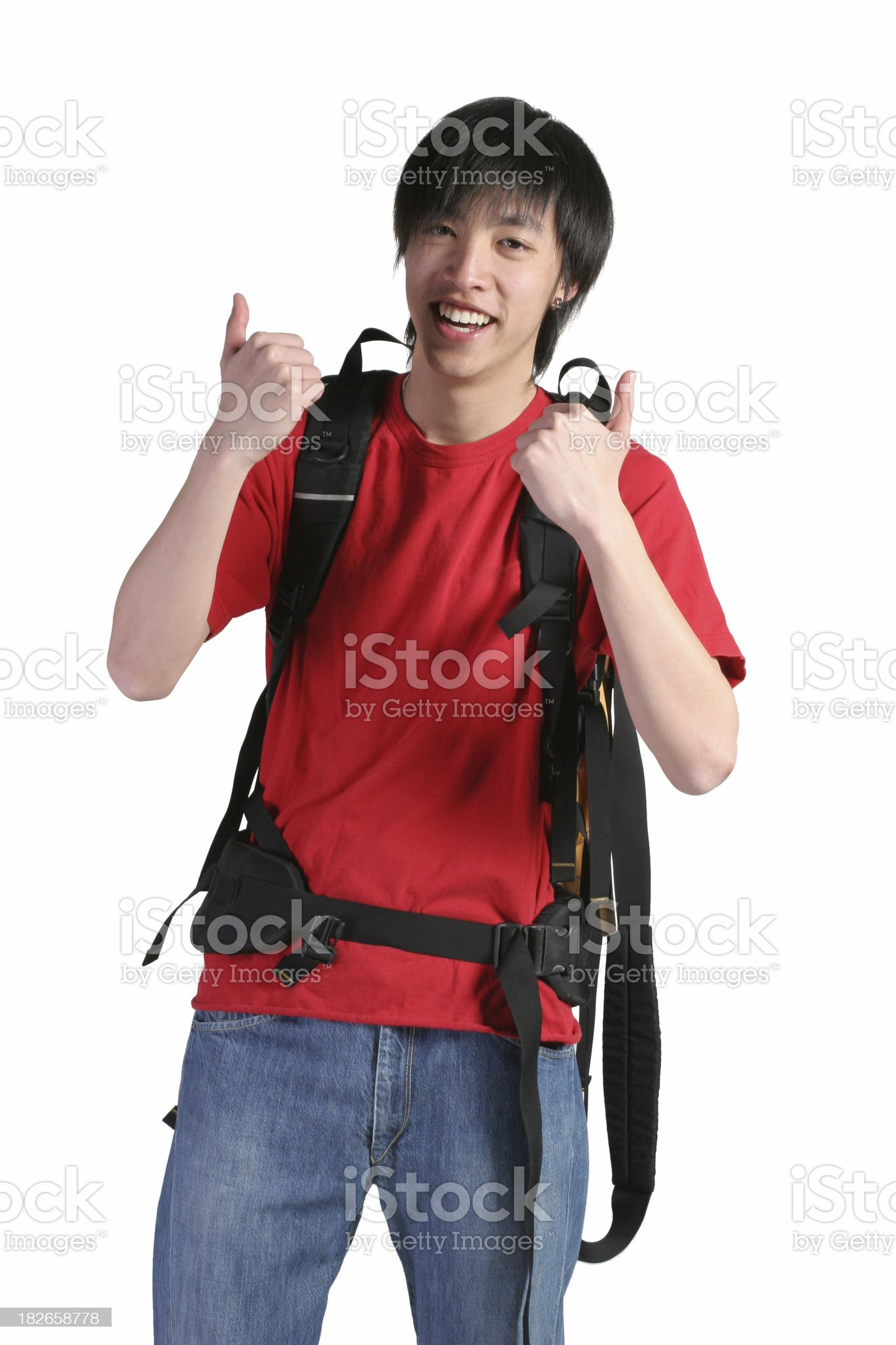 Cheerful young asian backpacker royalty-free stock photo