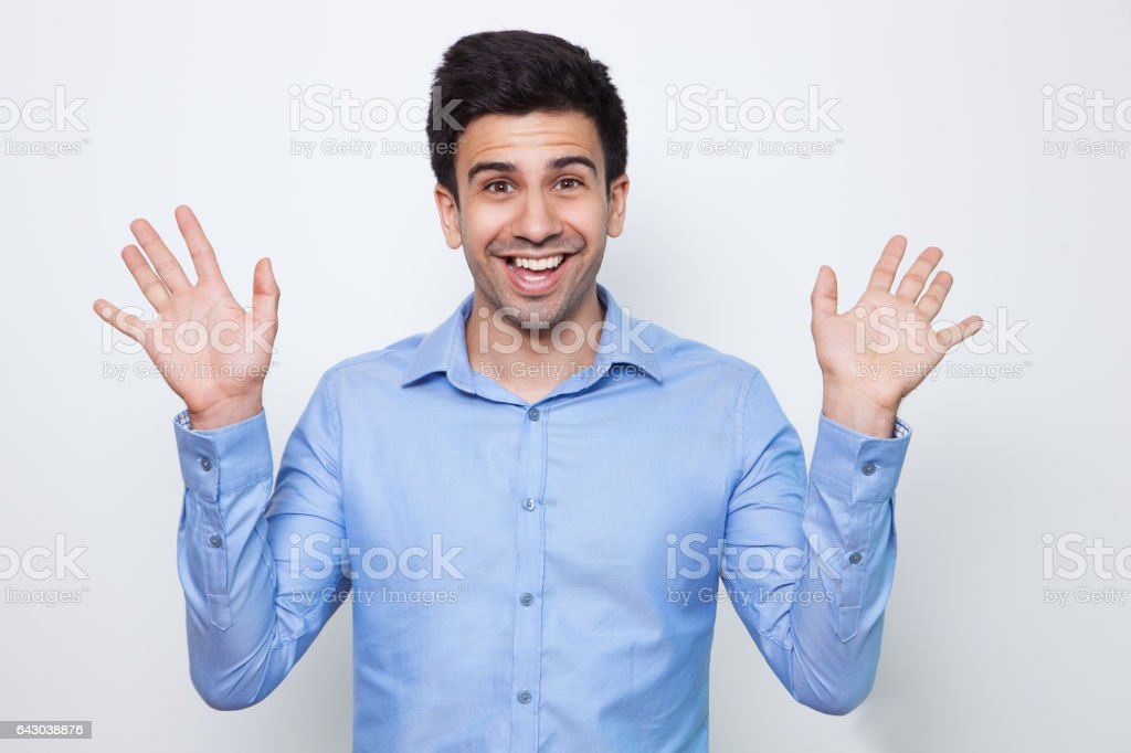 Cheerful Young Attractive Man Waving With Both Hands stock photo