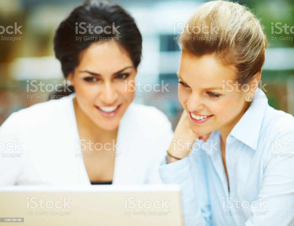 Cheerful young business people looking at computer royalty-free stock photo