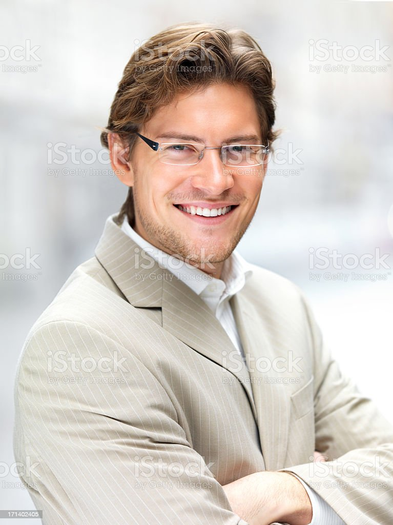 Cheerful young businessman stock photo