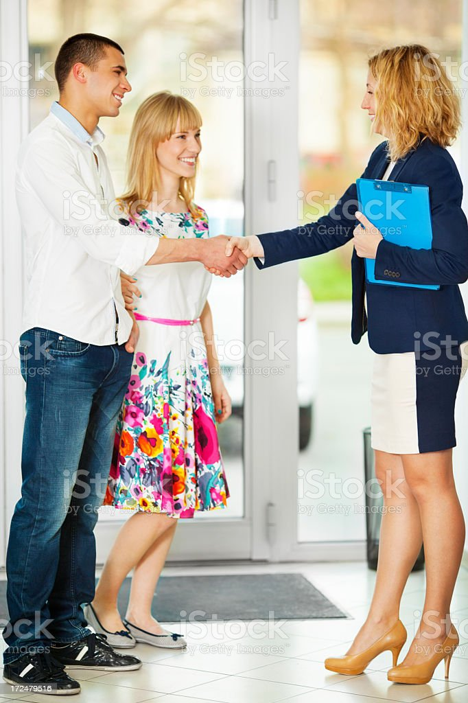 Cheerful Young Couple Buying Car. stock photo
