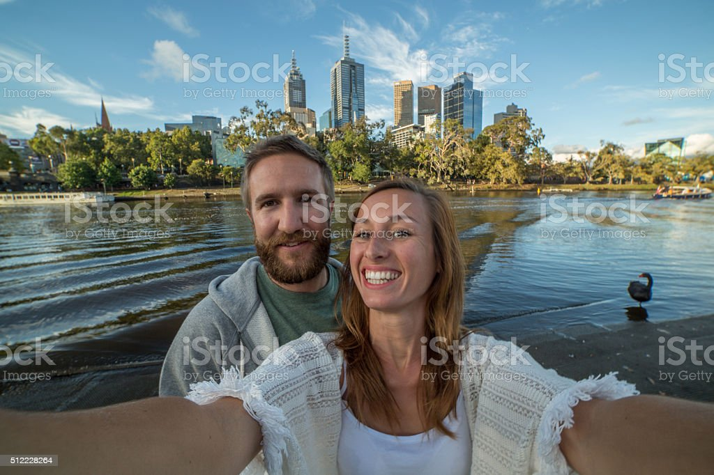 Cheerful young couple in Melbourne take a selfie portrait stock photo