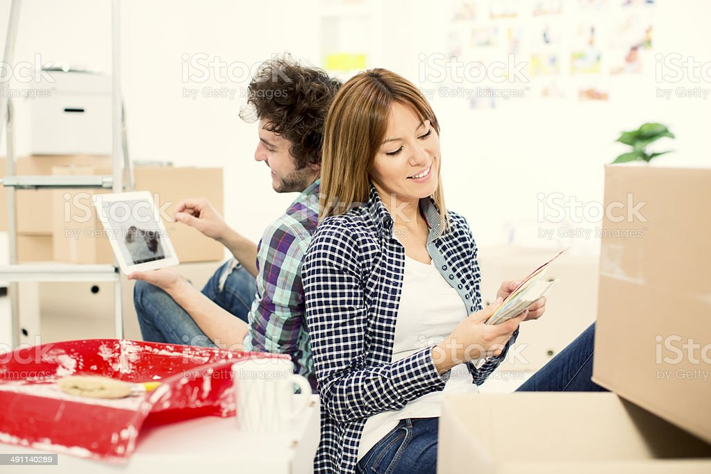 Cheerful young couple moving to new apartment. royalty-free stock photo