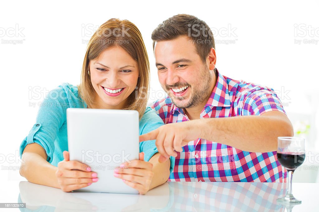 Cheerful Young Couple Using Digital Tablet. royalty-free stock photo