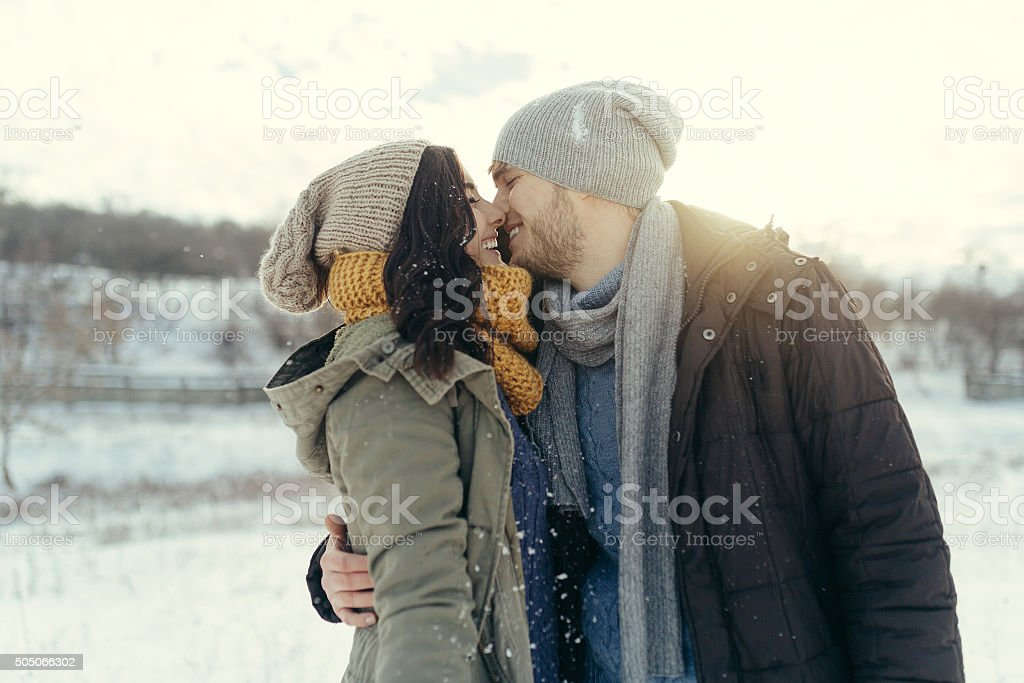 Cheerful young couple walking in a winter day stock photo