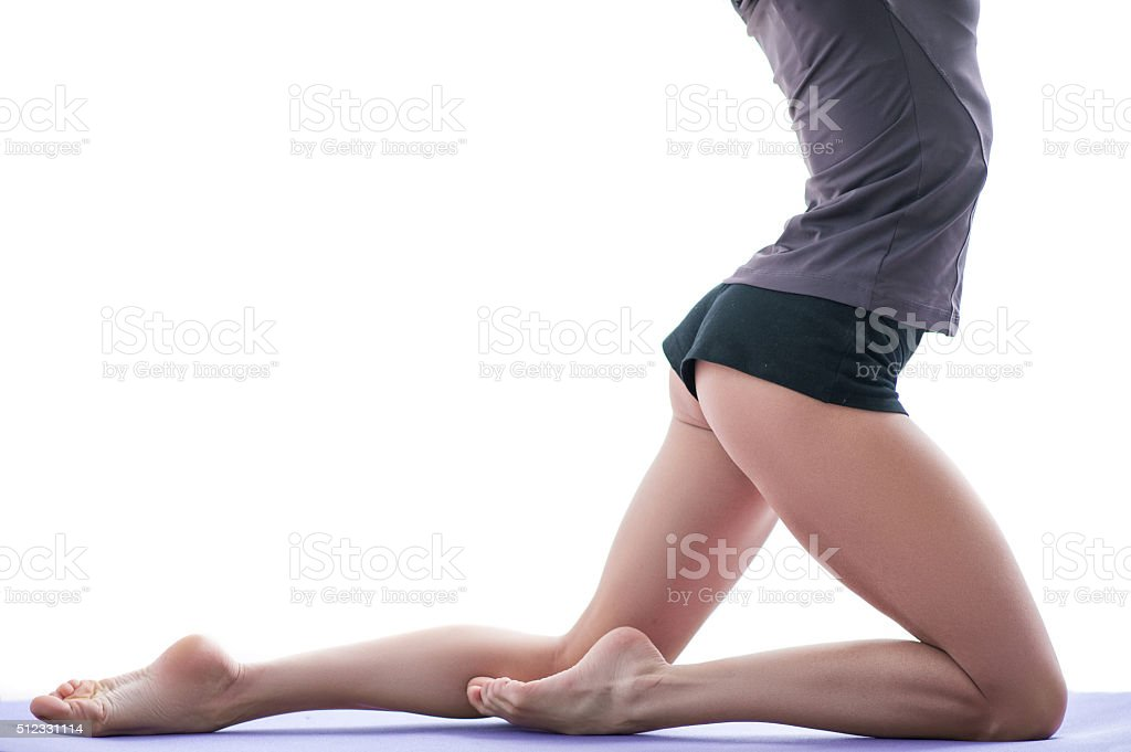 Cheerful young female athlete is doing exercise stock photo