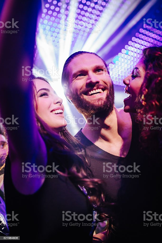 Cheerful young friends taking selfie at the club stock photo