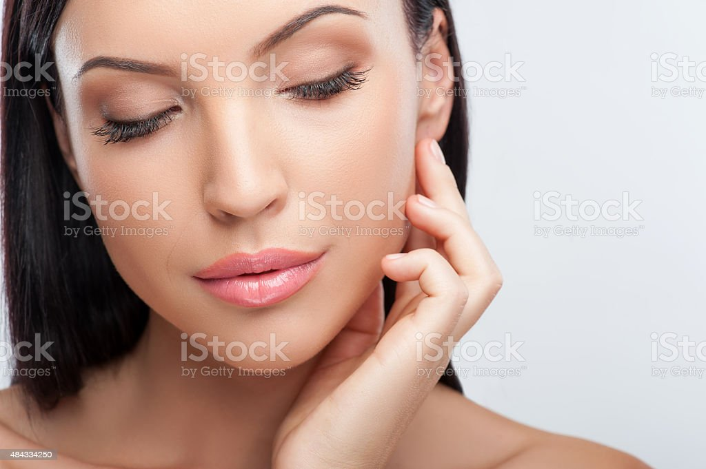 Cheerful young girl is caring of her skin stock photo