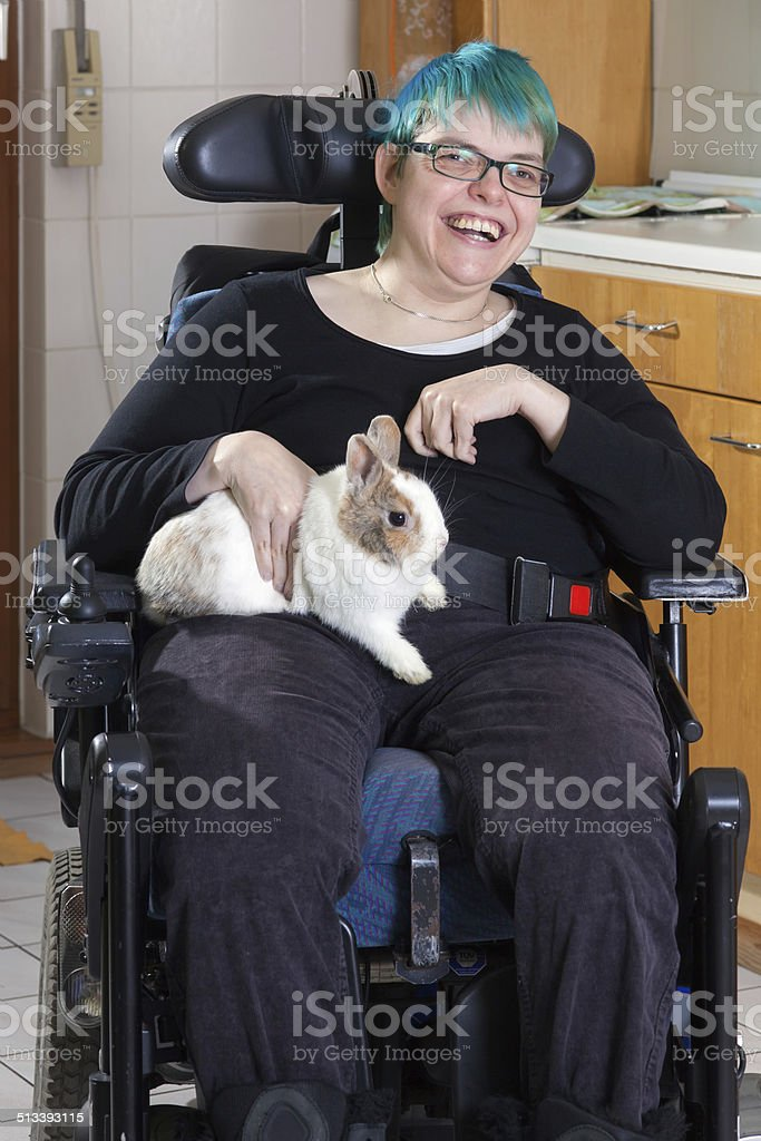 Cheerful young infantile cerebral palsy patient. stock photo