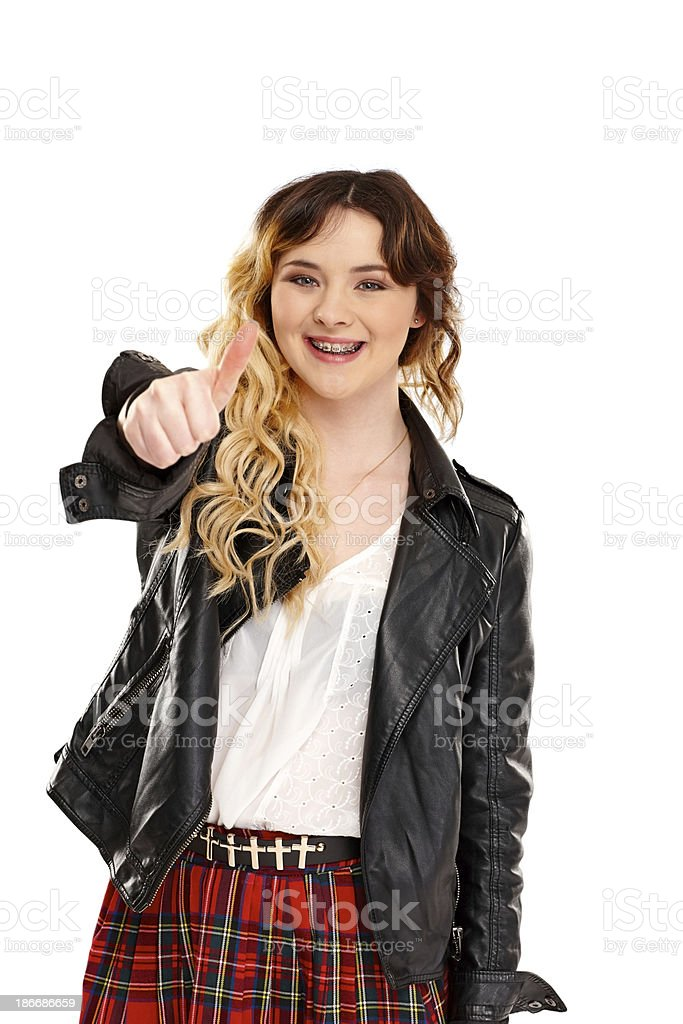 Cheerful young lady giving you thumbs up sign royalty-free stock photo