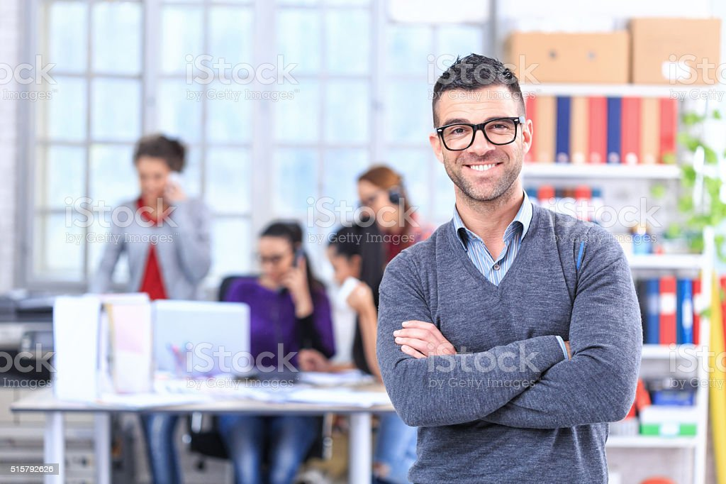 Cheerful young man at the office stock photo