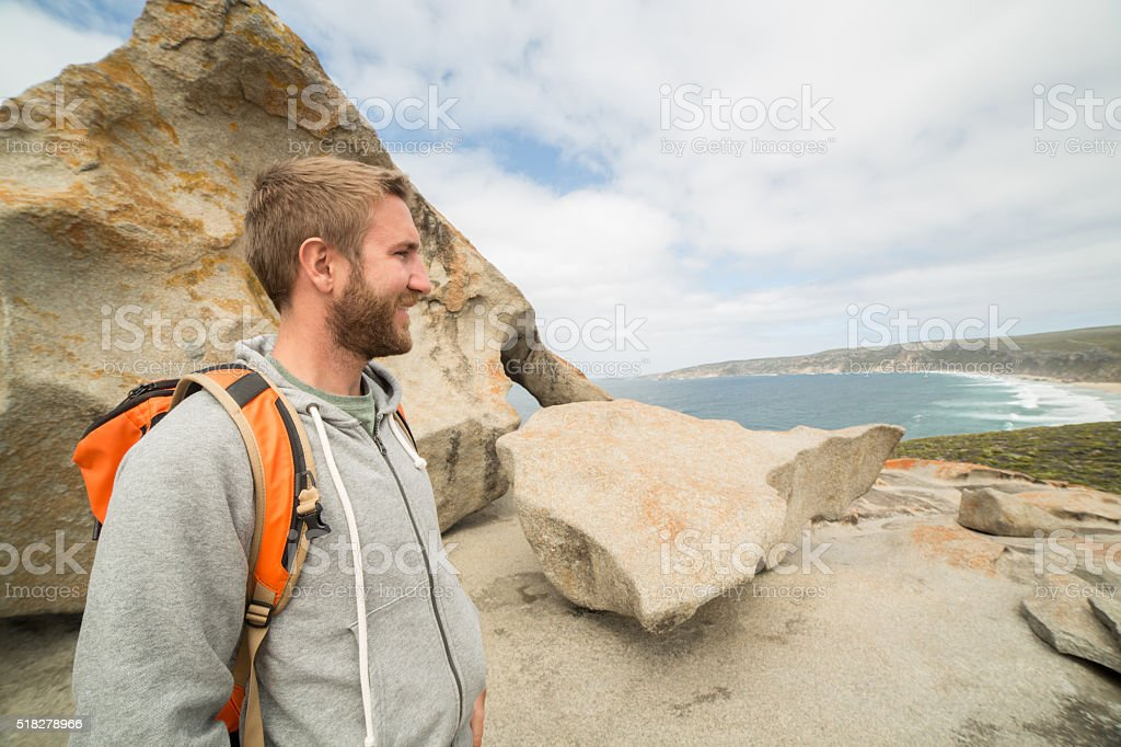 Cheerful young man at The Remarkable rocks stock photo