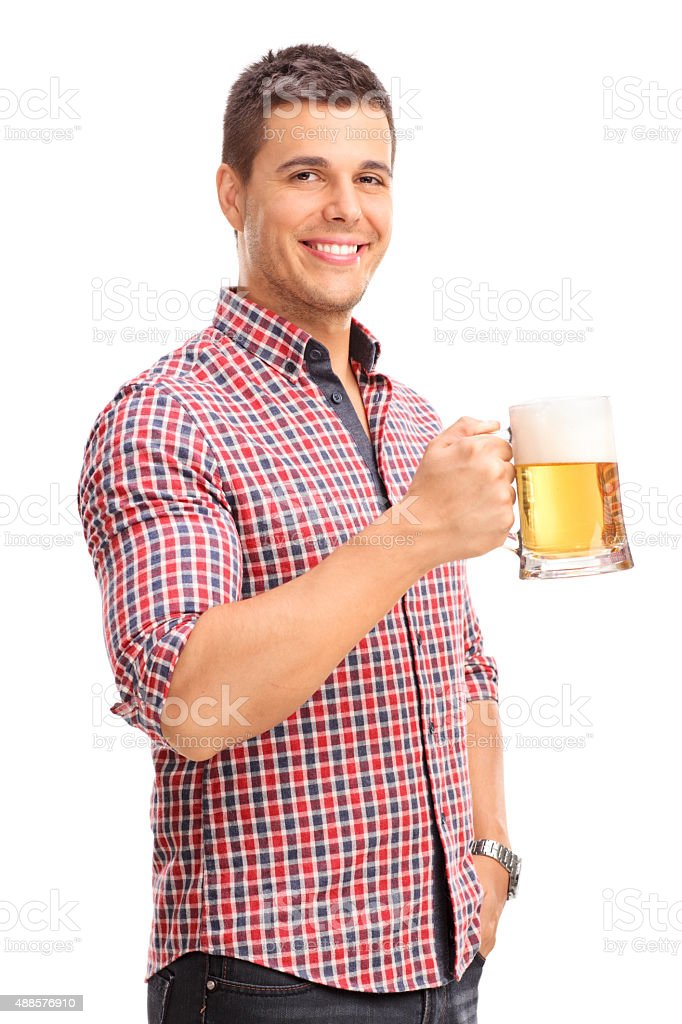 Cheerful young man holding a beer mug stock photo