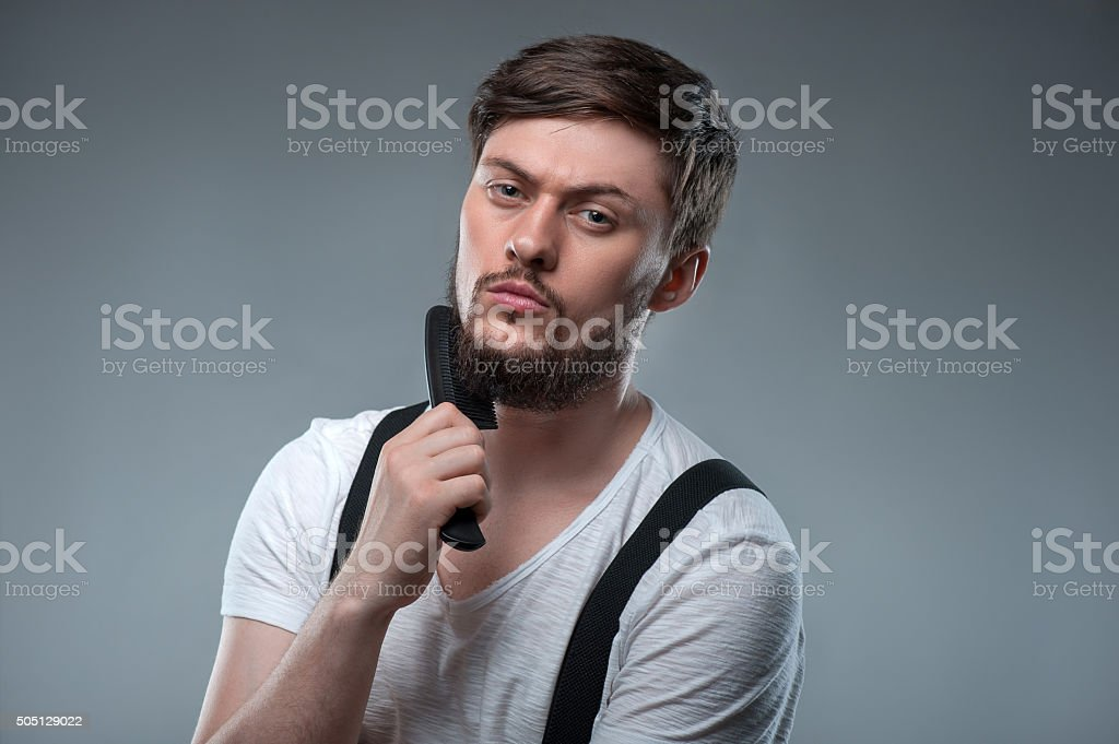 Cheerful young man is preparing for meeting stock photo