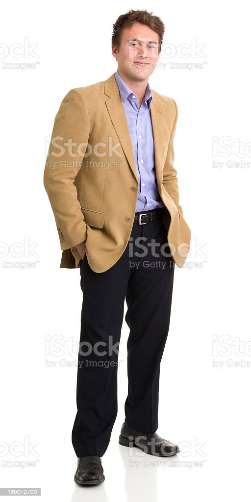 Cheerful young man standing alone stock photo