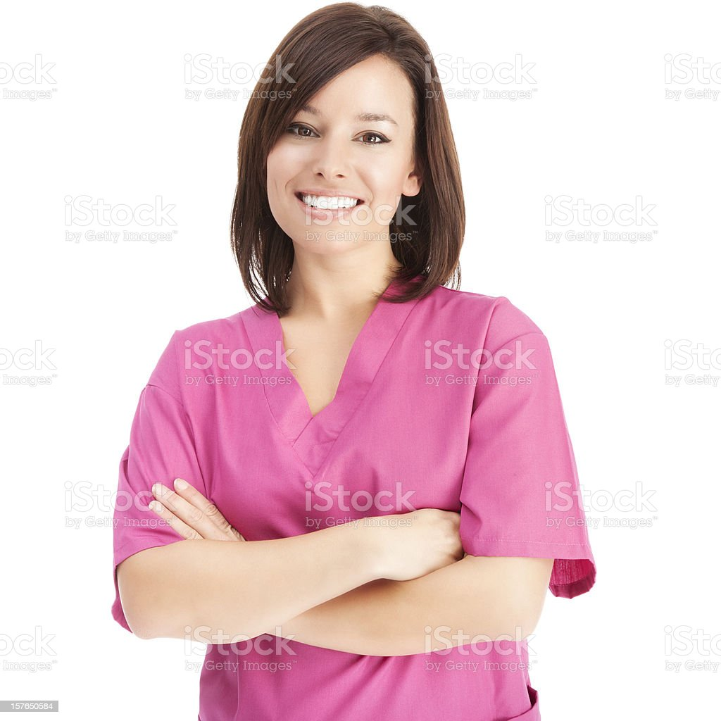 Cheerful Young Nurse in Pink Scrubs stock photo