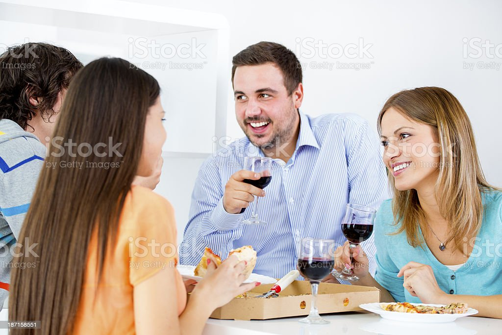 Cheerful Young People Eating Pizza. royalty-free stock photo