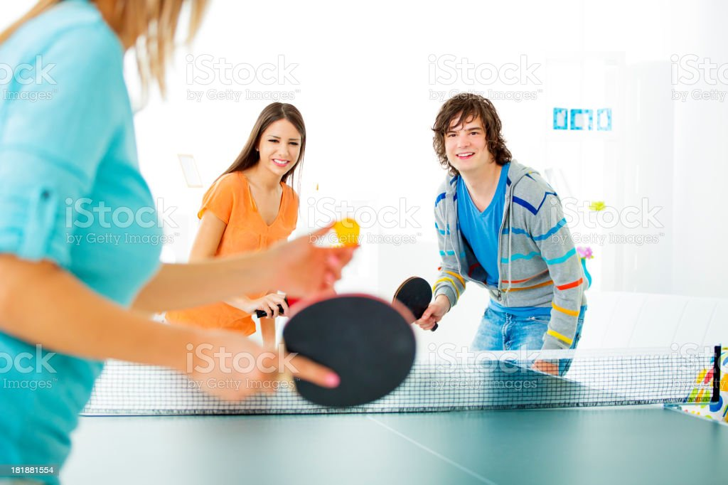 Cheerful Young People Playing Table Tennis. royalty-free stock photo