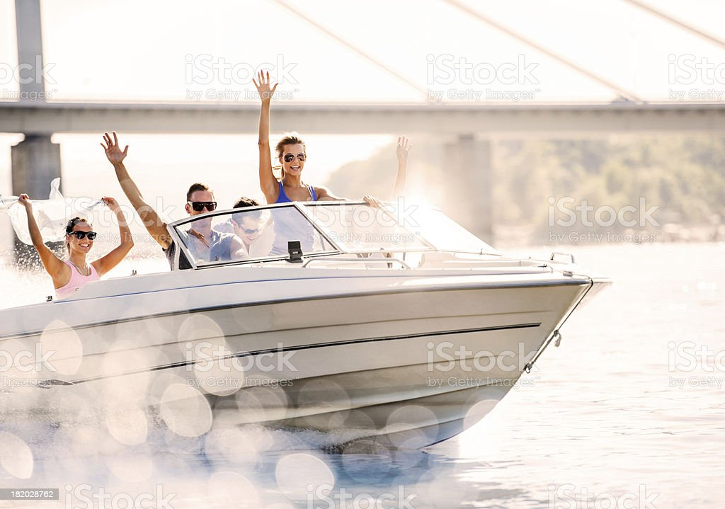 Cheerful young people riding in a speedboat. royalty-free stock photo
