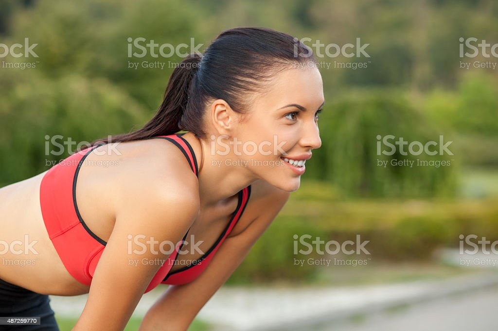 Cheerful young sport girl is preparing for jogging stock photo