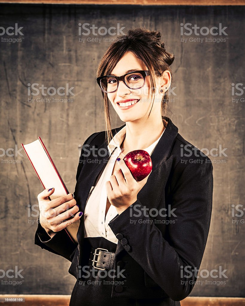 Cheerful Young Teacher whit Red Apple and Book