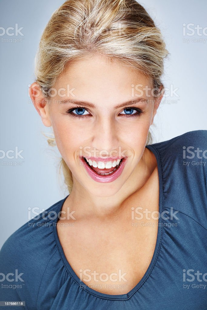 Cheerful young woman against colored background royalty-free stock photo