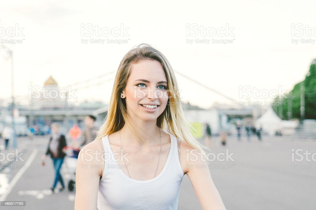 Cheerful Young Woman Cycling In The Park stock photo