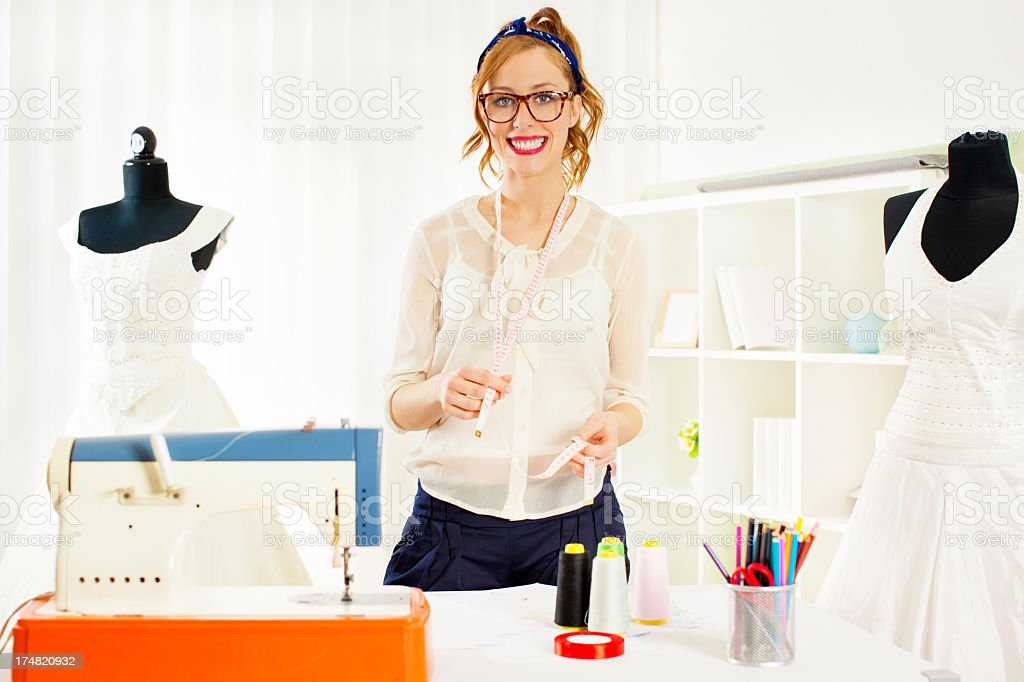 Cheerful Young Woman Dressmaker royalty-free stock photo