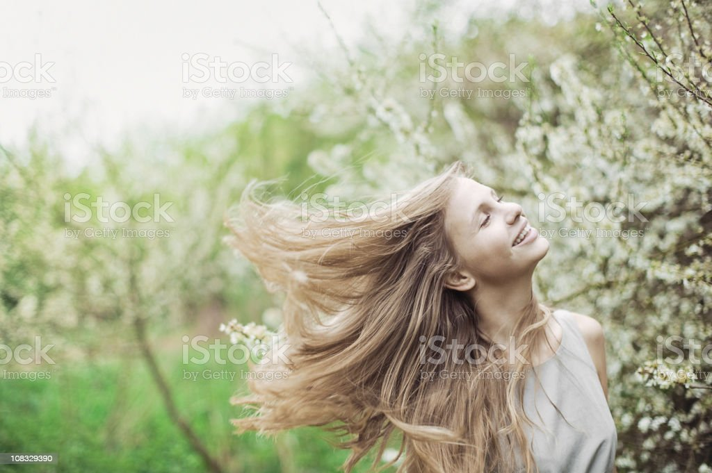 Cheerful young woman enjoying spring outside royalty-free stock photo