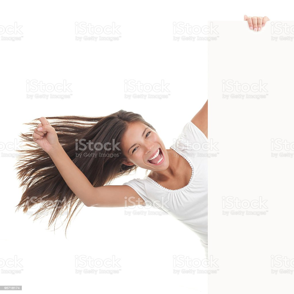 Cheerful young woman holding a white board royalty-free stock photo