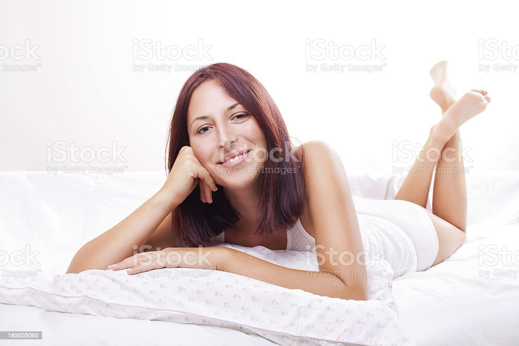 Cheerful Young Woman in Bed royalty-free stock photo