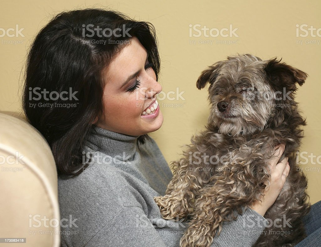 Cheerful Young Woman Looking At Her Small Dog royalty-free stock photo