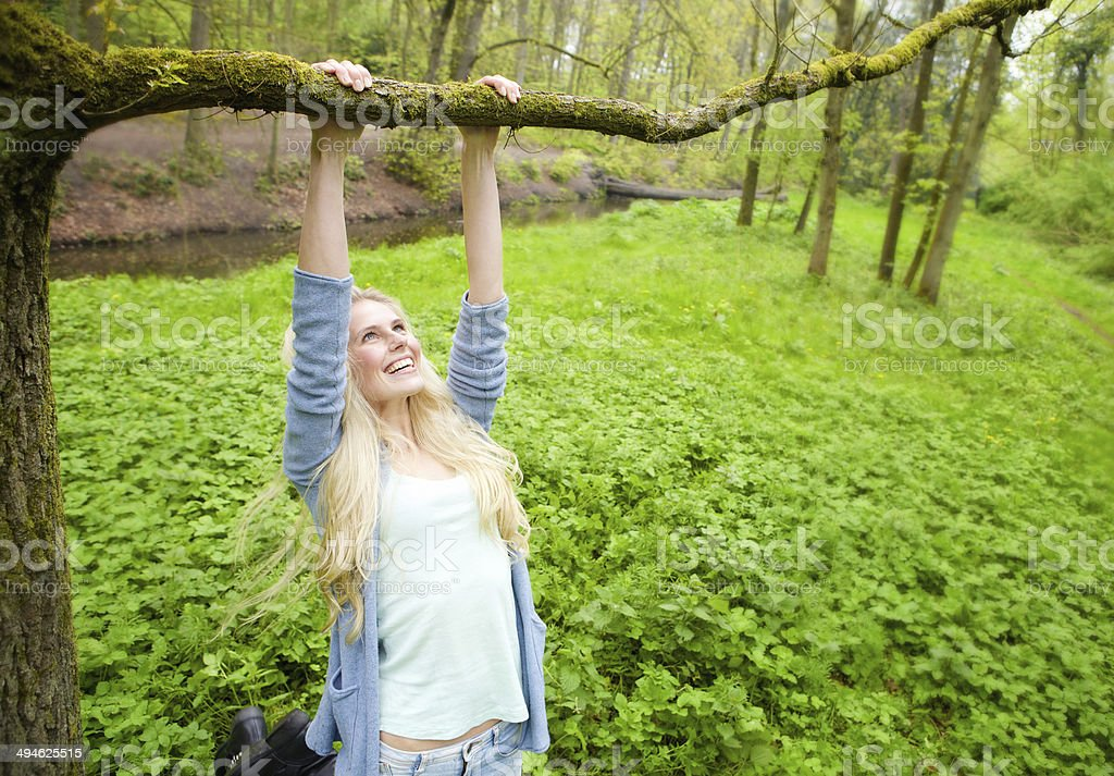 Cheerful young woman playing outdoors stock photo