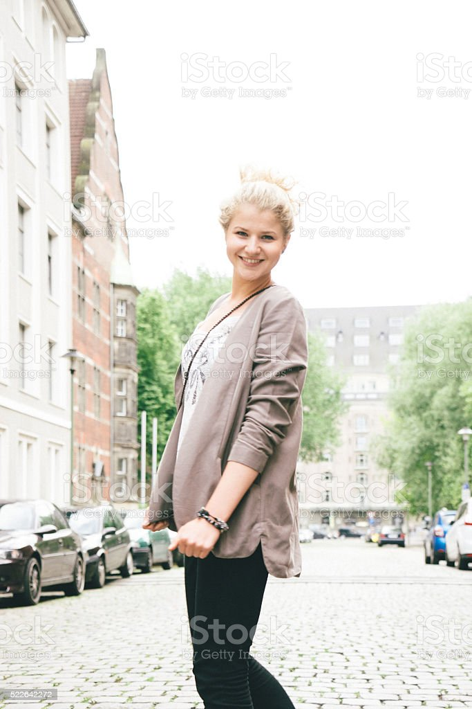 Cheerful Young Woman Portrait, City Street On Background stock photo