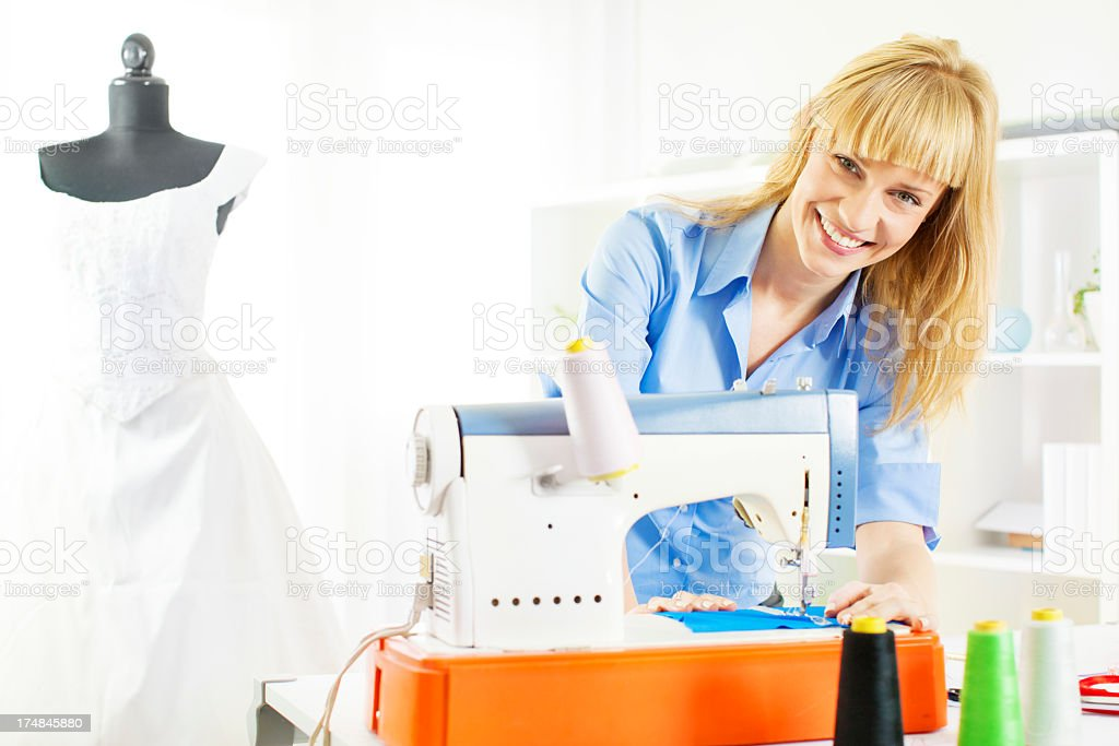 Cheerful Young Woman Sewing. royalty-free stock photo