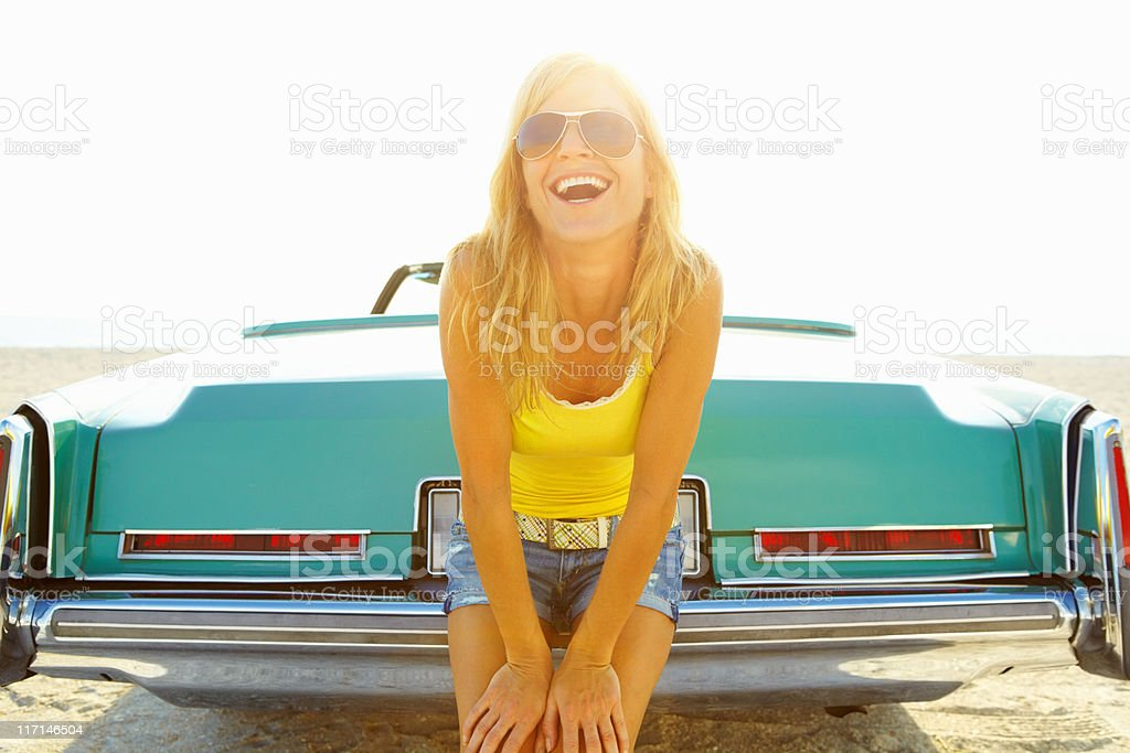 Cheerful young woman sitting at back of a car royalty-free stock photo
