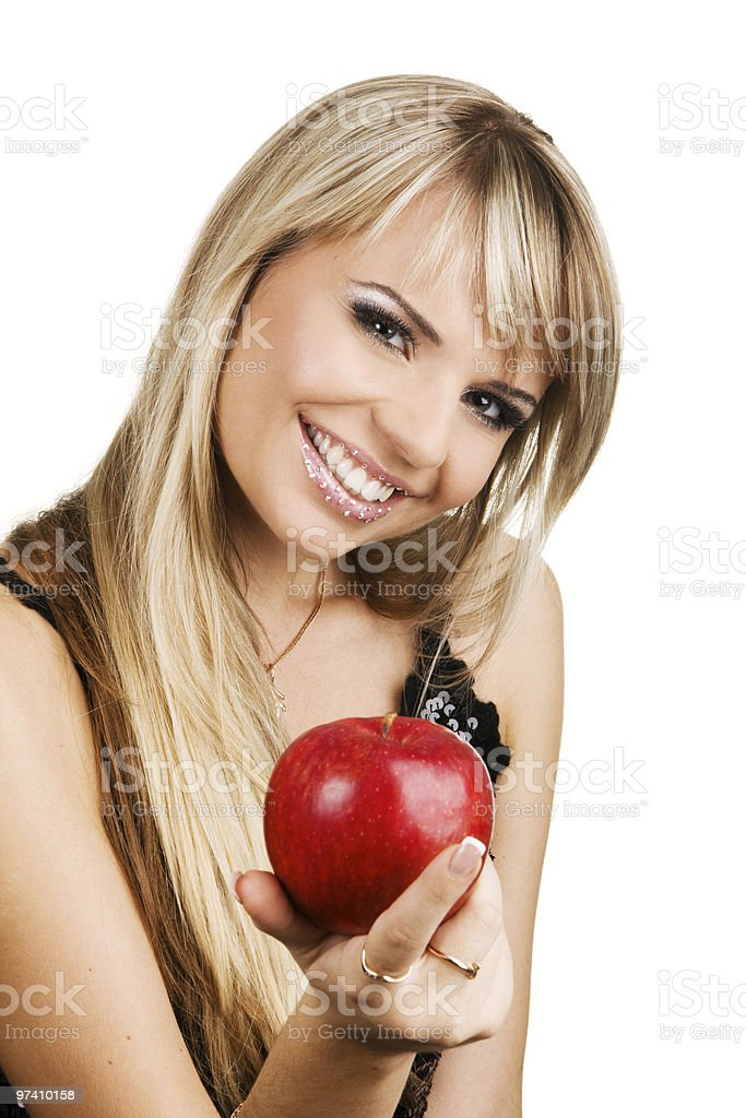 Cheerful young woman with an apple royalty-free stock photo