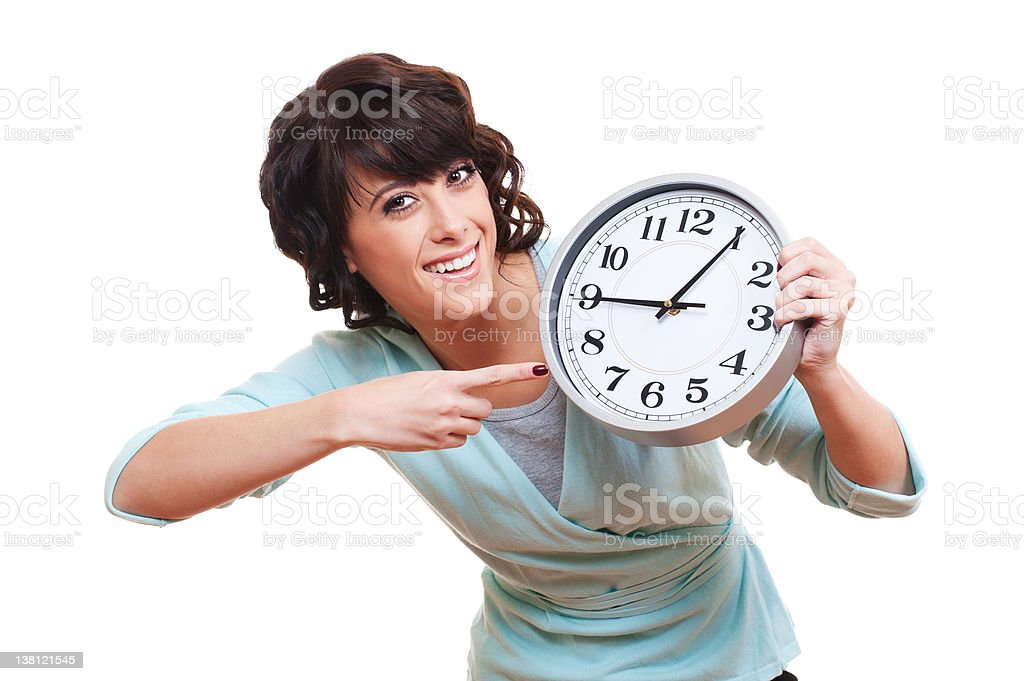 cheerful young woman with clock royalty-free stock photo