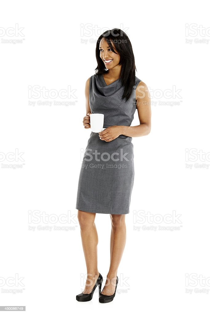 Cheerful young woman with cup of coffee looking at copyspace stock photo