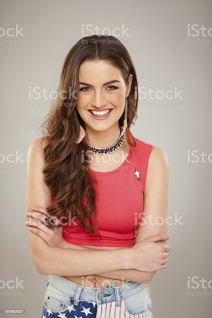 Cheerful young woman with her arms crossed royalty-free stock photo