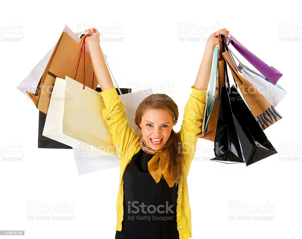 Cheerful young woman with shopping bags royalty-free stock photo
