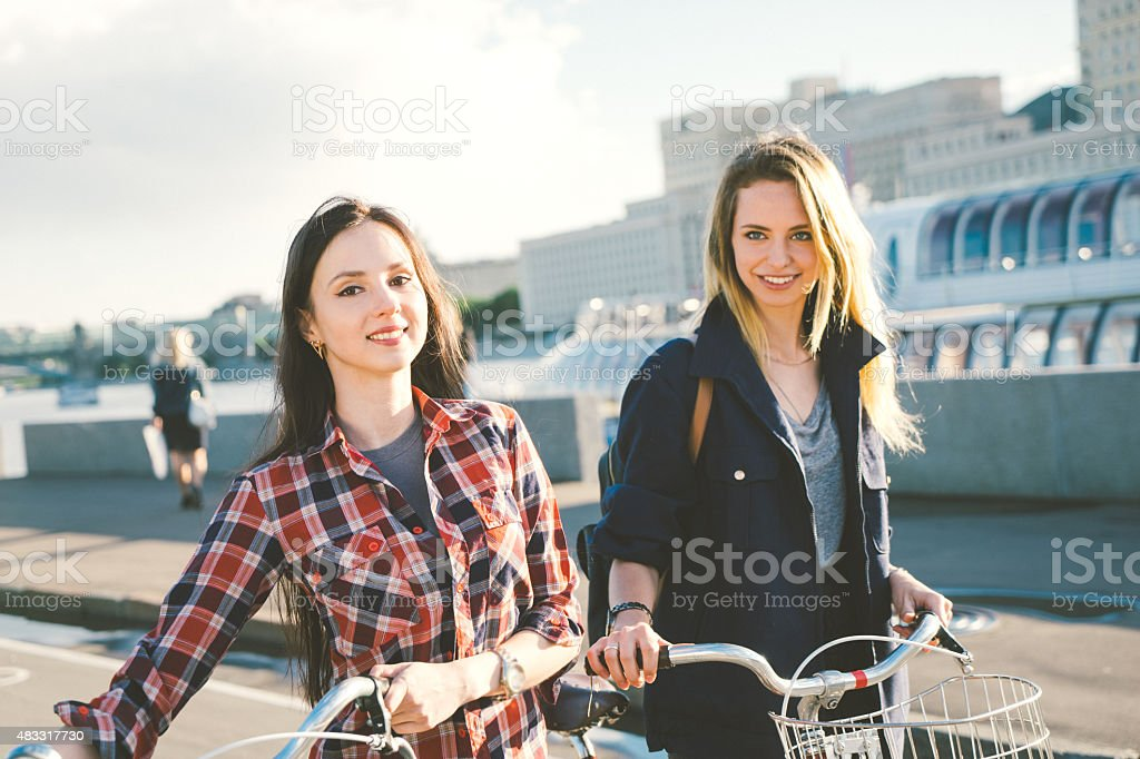 Cheerful Young Women Cycling In The Park stock photo