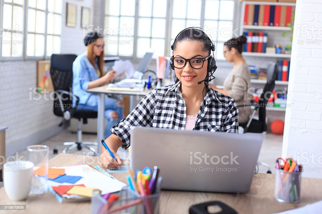 Cheerfull call center representative stock photo