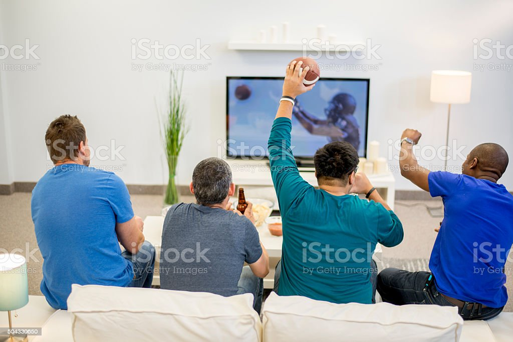 Cheering at the TV stock photo